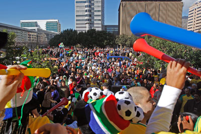 South Africans gather to show their support for the Bafana Bafna South African team and the Soccer World Cup by blowing on their vuvuzelas, in the city center of Cape Town, South Africa, Wednesday, June 9, 2010. (AP Photo/Schalk van Zuydam)