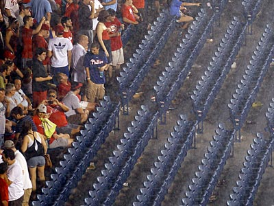 Phillies fans wait out the rain delay at Citizens Bank Park on Thursday night. (Yong Kim/Staff Photographer)