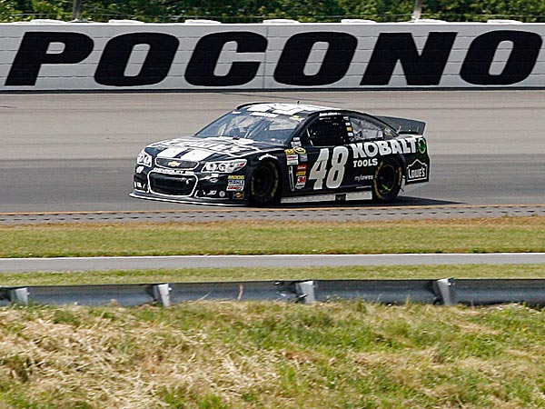 Jimmie Johnson absolutely dominated Sunday at Pocono Raceway, leading 128 of 160 laps for his third victory of the season. (Russ Hamilton Jr./AP)