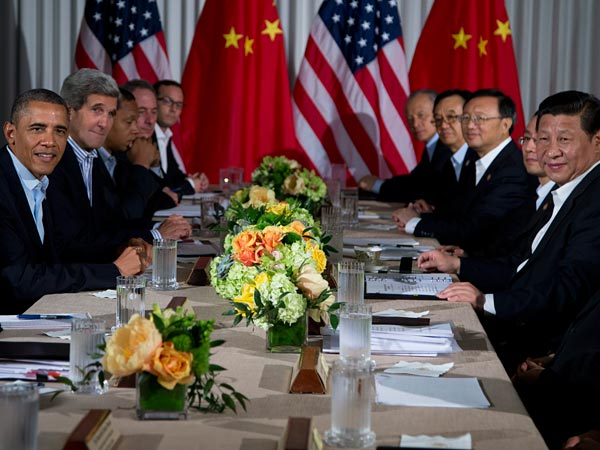 President Barack Obama, left, and Chinese President Xi Jinping, right, meet with their respective delegations at the Annenberg Retreat at Sunnylands on Saturday, June 8, 2013, in Rancho Mirage, Calif. The two world leaders shared a meal prepared by celebrity chef Bobby Flay. (Evan Vucci/AP Photo)