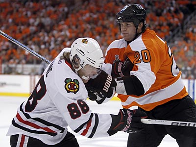 Chris Pronger shoves Patrick Kane during the second period of Game 6 of the Stanley Cup Finals June 9. (Yong Kim / Staff Photographer)