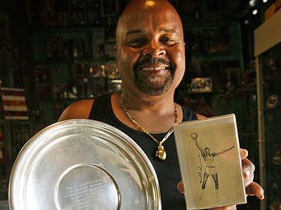 Ronald Toby owns a silver plate given to Wilt Chamberlain by the Dapper Dan Club of Pittsburgh. (Alejandro A. Alvarez/Staff Photographer)