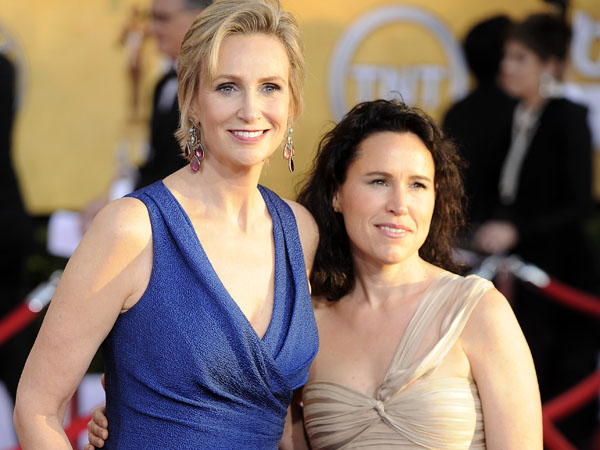 Jane Lynch, left, and Lara Embry arrive at the 18th Annual Screen Actors Guild Awards on Sunday Jan. 29, 2012 in Los Angeles. (AP Photo/Chris Pizzello)