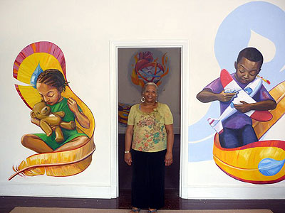 EMIR executive director Victoria Greene with the new mural at the agency´s office in Germantown. (Photo by Vernon Clark)
