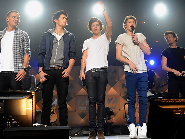 In this Dec. 7, 2012 file photo, members of One Direction, from left, Liam Payne, Zayn Malik, Harry Styles, Niall Horan, and Louis Tomlinson perform at Z100´s Jingle Ball 2012 in New York. It´s a crowded tour market and everyone is competing for your entertainment dollar. (Evan Agostini/Invision/AP)