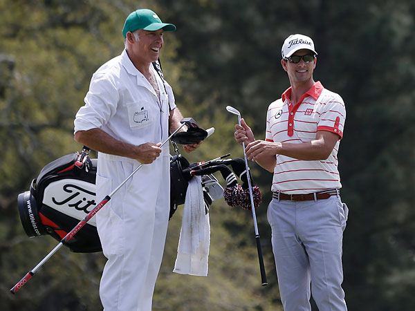 Steve Williams (left), who used to caddy for Tiger Woods, will work alongside Adam Scott at the U.S. Open. (Darron Cummings/AP file photo)