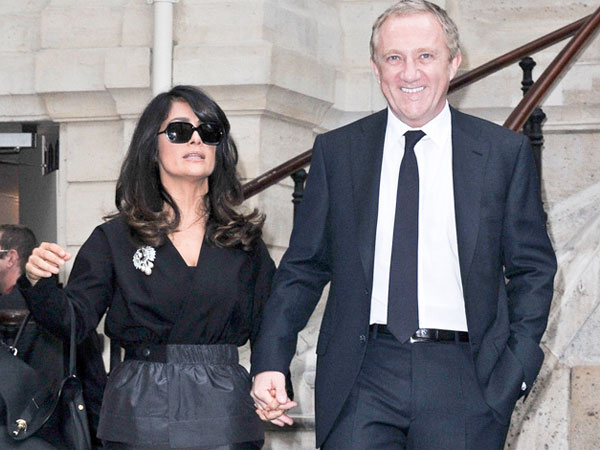 Salma Hayek, left, and Francois-Henri Pinault, arrives at the presentation of Balenciaga´s spring-summer 2013 ready to wear collection , in Paris, Thursday, Sept. 27, 2012. (AP Photo/Zacharie Scheurer)