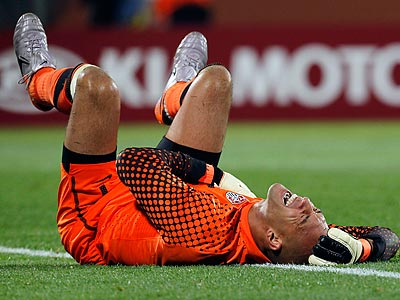 Tim Howard was injured in a hard collision with England forward Emile Heskey. (Eugene Hoshiko/AP