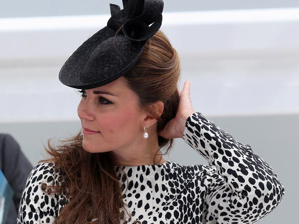 Britain´s Duchess of Cambridge attends a Princess Cruises ship naming ceremony to officially name the new Royal Princess cruise liner at a gala ceremony, in Southampton, England, Thursday June 13, 2013. It is expected to be her final planned solo event before the birth. (AP Photo/Chris Jackson, Pool)