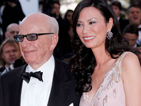 Media magnate Rupert Murdoch, left, and his wife Wendi Deng Murdoch arrive for the screening of The Tree of Life at the 64th international film festival, in Cannes, southern France, Monday, May 16, 2011. (AP Photo/Joel Ryan)