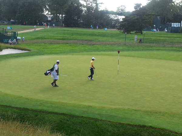 LaRue Temple, 30, of Philadelphia, (left) is caddie for amateur Michael Kim (in yellow) at the 113th U.S. Open at Merion Golf Club, June 13-16, 2013. (Photo courtesy of LaRue Temple)