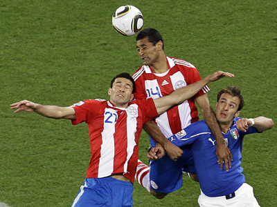 Italy´s Alberto Gilardino, right, Paraguay´s Paulo Da Silva, center, and Paraguay´s Antolin Alcaraz compete for the ball. (AP Photo/Themba Hadebe)