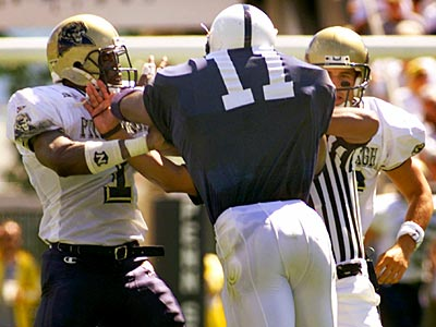 Penn State´s LaVar Arington and Pittsburgh´s D.J. Dinkins are separated during a 1999 game. (George Widman/AP)