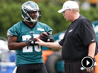 Eagles coach Andy Reid talks with LeSean McCoy during mini-camp on Wednesday. (David Maialetti/Staff Photographer)