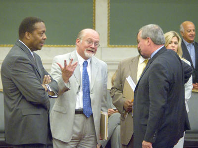 Council President Darrell Clarke, left talks with fellow councilmen William Greenlee, Curtis Jones (partially hidden) and James Kenney before Thursday´s session. (Ed Hille / Staff Photographer)