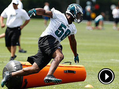 Defensive end Trent Cole spins around a blocking pad during minicamp. (David Maialetti/Staff Photographer)