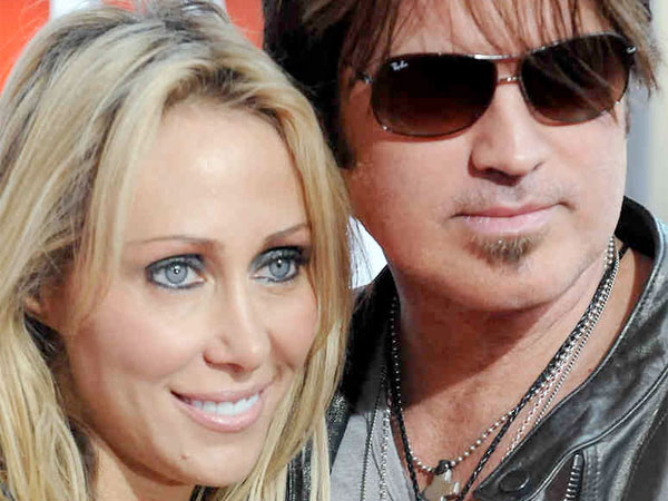 "Billy Ray Cyrus and wife ""Tish"" Finley (above) are splitting. Again. (AP Photo)"