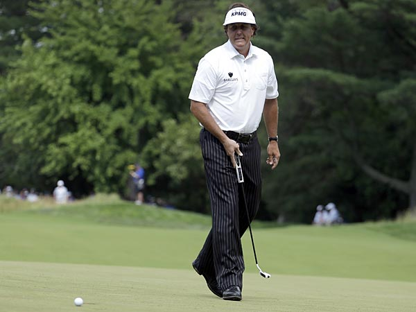 Phil Mickelson reacts to a missed putt on the first hole during the<br />second round of the U.S. Open golf tournament at Merion Golf Club,<br />Friday, June 14, 2013, in Ardmore, Pa. (Darron Cummings/AP)