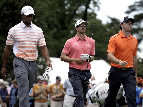 Tiger Woods, from left, Adam Scott and Rory McIlroy walk down from a tee box during the second round of the U.S. Open at Merion. (Gene J. Puskar/AP)