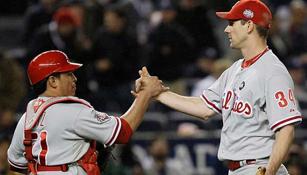 Phillies catcher Carlos Ruiz greets starter Cliff Lee after his Game 1 victory over the Yankees in the 2009 World Series. (AP Photo / David J. Phillip)