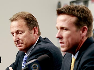 Union CEO Nick Sakiewicz listens to interim manager John Hackworth during a press conference on Wednesday. (Yong Kim/Staff Photographer)