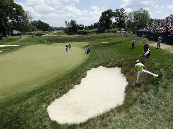 Jamie Donaldson, of Wales, hits on the 17th hole during the third round of the U.S. Open golf tournament at Merion Golf Club, Saturday, June 15, 2013, in Ardmore, Pa. (AP Photo/Julio Cortez)