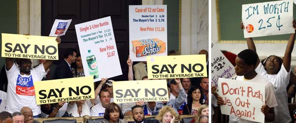 Opponents (left) of a proposal to tax soda and other sugary drinks display signs at a City Council hearing Thursday, while supporters stress the school-funding aspect with their own signs (AP Photos/Matt Rourke)