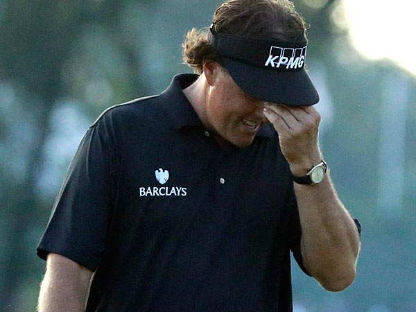Phil Mickelson reacts after missing a shot on the 18th hole during the fourth round of the U.S. Open golf tournament at Merion Golf Club, Sunday, June 16, 2013, in Ardmore, Pa. (AP Photo/Morry Gash)