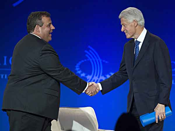 Former President Bill Clinton, right, shakes Gov. Christie´s hand as he arrives on stage during the Clinton Global Initiative (CGI) Meeting in Chicago, Friday, June 14, 2013. (AP Photo/Scott Eisen)