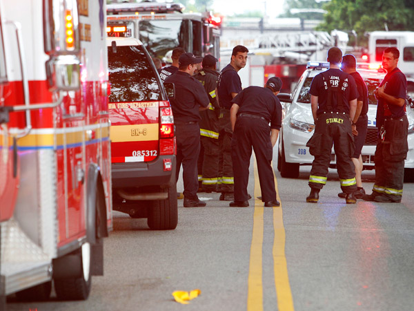 Philadelphia Fire Department personnel along Erie Ave between 19th and 20th streets where an alleged assault took place with medics after an accident along Roosevelt Boulevard. (ALEJANDRO A. ALVAREZ / STAFF PHOTOGRAPHER)