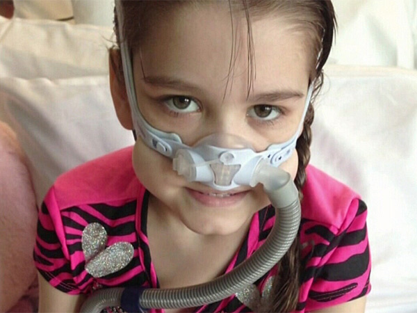 Sarah Murnaghan wears a mask at the Children&acute;s Hospital of Philadelphia. Sarah received two lung transplants. (family photo)<br /><br /><br />