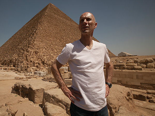 Bob Bradley poses for a photo in front of one of the Great Pyramids. (Photo courtesy of PBS)
