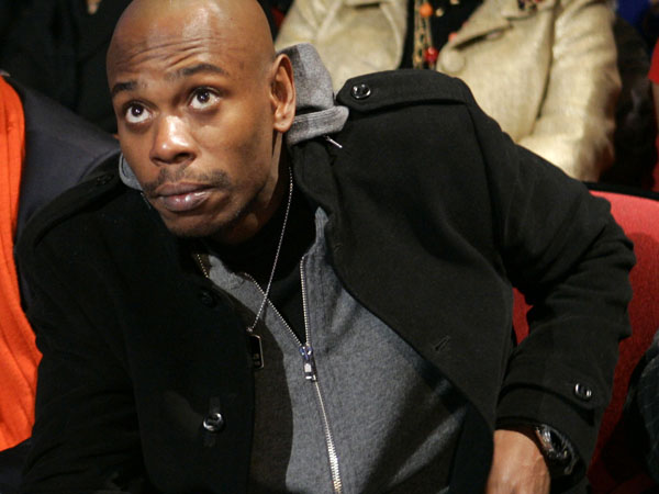 Comedian Dave Chappelle attends the Democratic presidential debate sponsored by CNN and the Congressional Black Caucus Institute between Democratic presidential hopefuls Sen. Barack Obama, D-Ill., Sen. Hillary Clinton, D-N.Y., and former Sen., John Edwards, D-N.C.,  in Myrtle Beach, S.C., Monday, Jan. 21, 2008. (AP Photo/Charles Rex Arbogast)