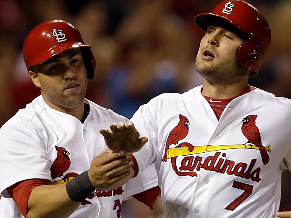 St. Louis Cardinals´ Matt Holliday, right, and Carlos Beltran celebrate after scoring on a two-run double by Yadier Molina during the fouth inning of a baseball game against the Chicago Cubs on Monday, June 17, 2013, in St. Louis. (AP Photo/Jeff Roberson)