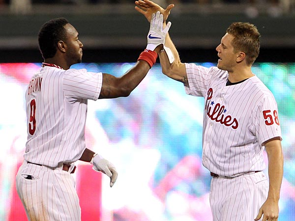 Phillies outfielder Domonic Brown (left) and closer Jonathan Papelbon. (Yong Kim/Staff file photo)