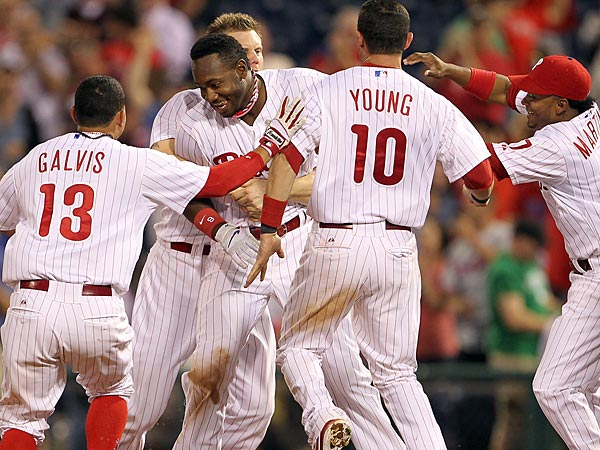 Phillies&acute; Domonic Brown celebrates his game RBI single with this<br />teammates during the bottom of the ninth-inning against the Washington<br />Nationals played on Monday, June 17, 2013.  (Yong Kim/Staff<br />Photographer)