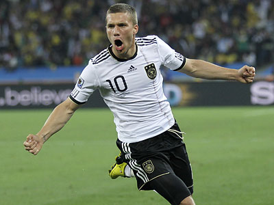 Lukas Podolski and Germany will have to mentally prepare to face Uruguay after losing to Spain. (Julie Jacobson/AP)