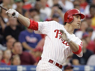 Chase Utley watches his three-run home run in the second inning. (AP Photo/Tom Mihalek)