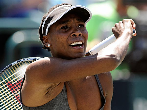 After 16 consecutive years of always showing up at Wimbledon, Venus Williams pulled out of the grass-court Grand Slam tournament Tuesday. (Stephen Morton/AP)