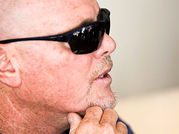 Jim McMahon spoke Tuesday of his ongoing battle with dementia that he believe is related to his years of hits he took while playing in the NFL. (Stacy Thacker/AP)