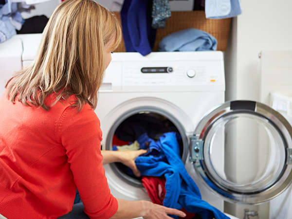 Your laundry can become more environmentally friendly based on the amount of energy and water you consume and the types of products you use to get your clothes clean. (iStock)
