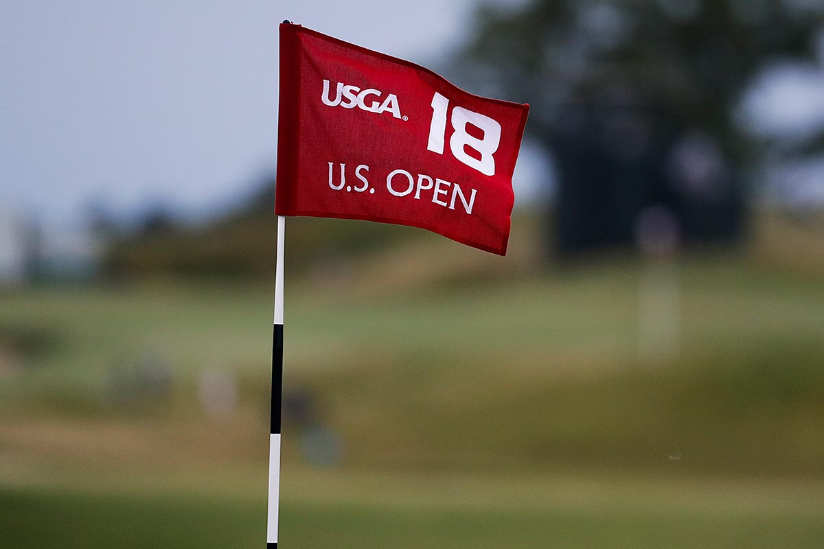 The flag on the 18th green blows in the wind during the second round of the U.S. Open golf tournament Friday, June 16, 2017, at Erin Hills in Erin, Wis.