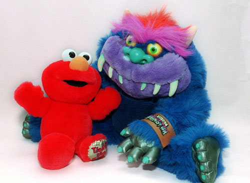 "In this mildly disturbing 2001 AP file photo: ""Tickle Me Elmo"" sits in the arm of ""My Pet Monster."" (AP Photo / Marty Lederhandler)"