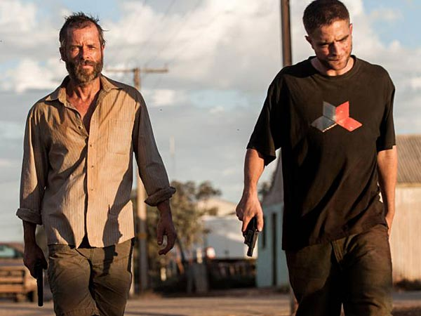 "This image released by A24 Films shows Guy Pearce, left, and Robert Pattinson in a scene from ""The Rover."" (AP Photo/A24 Films, Matt Nettheim)"