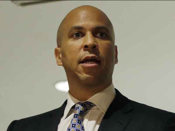 Senate candidate Newark Mayor Cory Booker addresses a gathering of supporters at an event in Deptford Township, N.J. Tuesday, June 18, 2013. A Quinnipiac University poll has Booker with 53 percent of Democratic support in a four-way primary.   (AP Photo/Mel Evans)