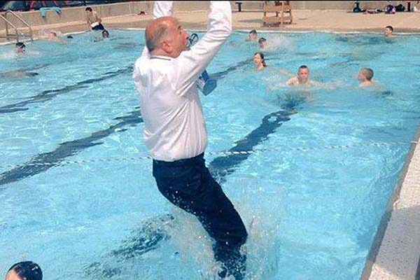 Philadelphia City Council Mark Squilla takes the plunge at the Murphy Recreation Center on the first day of public pool season.