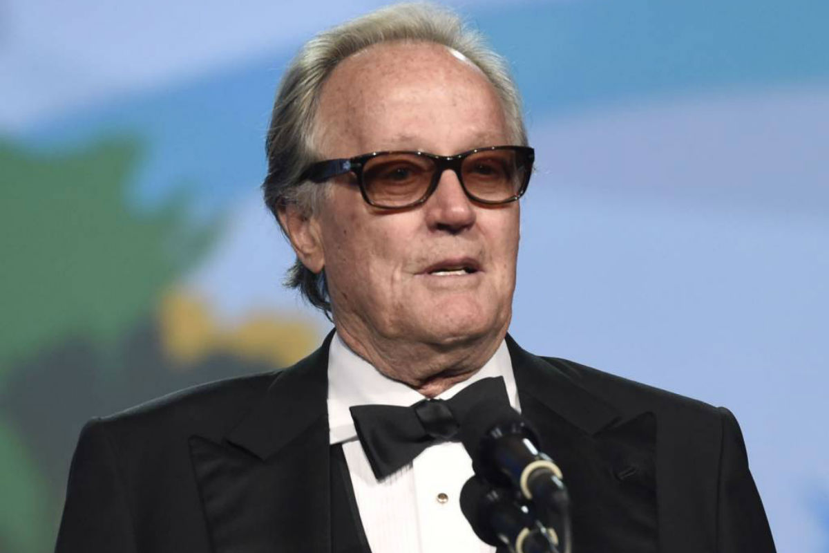 "FILE - In this Jan. 2, 2018 file photo, Peter Fonda presents the Desert Palm achievement award at the 29th annual Palm Springs International Film Festival in Palm Springs, Calif. Fonda has apologized for a late-night Twitter rant that said 12-year-old Barron Trump should be ripped from ""his mother's arms and put in a cage with pedophiles.� The all-capitals tweet early Wednesday went on to call President Donald Trump an expletive. Fonda later deleted the tweet and drew sharp rebukes from first lady Melania Trump and Donald Trump Jr."