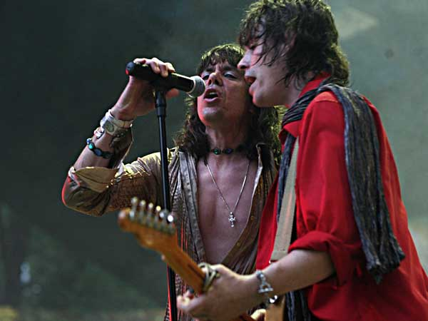 Keith Call (left) does his Mick Jagger while Glimmer Twins bandmate Bernie Bollendorf (right) does Keith Richards during their Rolling Stones tribute band performance at the Pennypack Park Music Festival. They´ve been playing the free, summerlong, all tribute band festival for six years, attracting thousands of fans to the Ed Kelly Amphitheater on the banks of Pennypack Creek.  (Photo by LoRusso Studios)