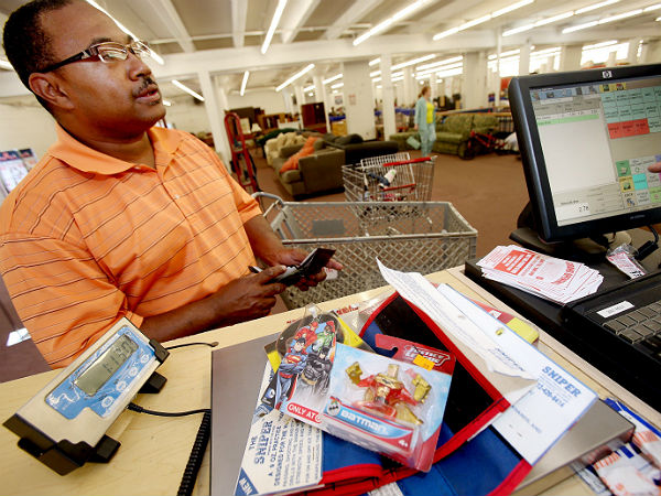 Rodney Lewis takes advantage of a new program at the Salvation Army of selling by the pound in Minneapolis on June 5, 2014. (Joel Koyama /    Minneapolis Star Tribune / MCT)