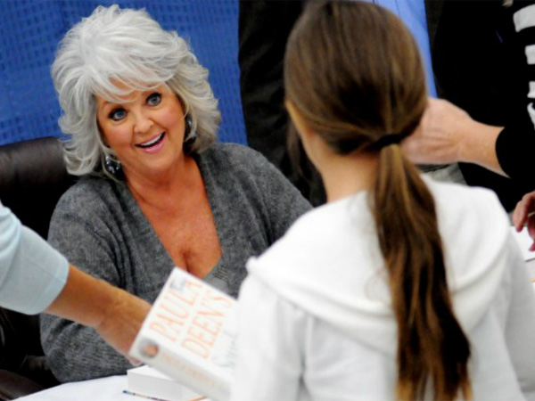 "Deen at a book signing for her ""Southern Cooking Bible"" at a Louisiana Wal-Mart. Fans are furious at the Food Network for dumping the comfort-food queen after she acknowledged using racial slurs in the past."